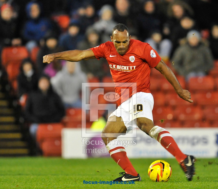 Picture by Richard Land/Focus Images Ltd +44 7713 507003<br /> 09/11/2013<br /> Chris O'Grady of Barnsley tries a long range shot during the Sky Bet Championship match at Oakwell, Barnsley.