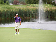 Blayne Hobbs of Anthem, Arizona lines up his shot on the fourth hole during the second round of the Greater Cedar Rapids Open held at Hunters Ridge Golf Course in Marion on Saturday, July 23, 2011.
