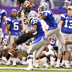 Dec 20, 2009; New Orleans, LA, USA; Southern Miss Golden Eagles wide receiver DeAndre Brown (5) is defended by Middle Tennessee State Blue Raiders cornerback Marcus Udell (3) and safety Kevin Brown (33) during the 2009 New Orleans Bowl at the Louisiana Superdome. Middle Tennessee State defeated Southern Miss 42-32. Mandatory Credit: Derick E. Hingle-US PRESSWIRE