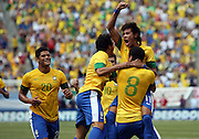 JUNE 09 2012:   Neymar (11) of Brazil  congratulates Romulo (8) after he had scored the first goal during an international friendly match against Argentina at Metlife Stadium in East Rutherford,New Jersey. Argentina won 4-3.