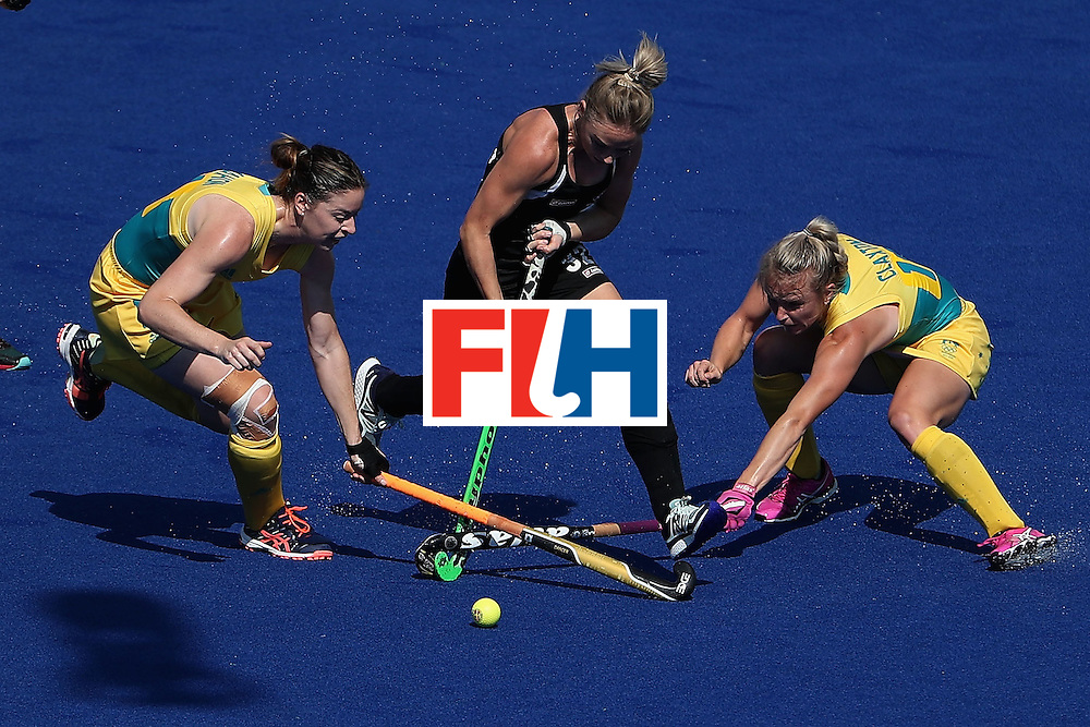 RIO DE JANEIRO, BRAZIL - AUGUST 15:  Anita Mclaren #32 of New Zealand attepts to move the ball past Karri Mcmahon #11 and Jane-Anne Claxton #18 of Australia during the first half of the quarter final hockey game on Day 10 of the Rio 2016 Olympic Games at the Olympic Hockey Centre on August 15, 2016 in Rio de Janeiro, Brazil.  (Photo by Christian Petersen/Getty Images)