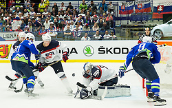 Miha Verlic of Slovenia and Tomaz Razingar of Slovenia vs Connor Murphy of USA and Connor Hellebuyck of USA during Ice Hockey match between Slovenia and USA at Day 10 in Group B of 2015 IIHF World Championship, on May 10, 2015 in CEZ Arena, Ostrava, Czech Republic. Photo by Vid Ponikvar / Sportida
