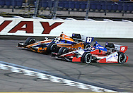 during the IZOD IndyCar Iowa Corn Indy 250 auto race at the Iowa Speedway in Newton, Iowa on Saturday, June 23, 2012.