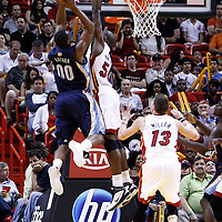 12 March 2011: Miami Heat center Joel Anthony (50) blocks Memphis Grizzlies power forward Darrell Arthur (00) during the Miami Heat 118-85 victory over the Memphis Grizzlies at the AmericanAirlines Arena, Miami, Florida, USA. **