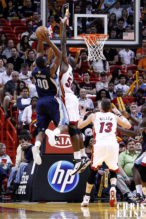 12 March 2011: Miami Heat center Joel Anthony (50) blocks Memphis Grizzlies power forward Darrell Arthur (00) during the Miami Heat 118-85 victory over the Memphis Grizzlies at the AmericanAirlines Arena, Miami, Florida, USA. **