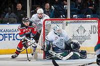 KELOWNA, CANADA - DECEMBER 7: Nick Merkley #10 of the Kelowna Rockets is back checked by Mathew Barzal #13 as he attempts a wrap around goal on Rylan Toth #31 of the Seattle Thunderbirds on December 7, 2016 at Prospera Place in Kelowna, British Columbia, Canada.  (Photo by Marissa Baecker/Shoot the Breeze)  *** Local Caption ***