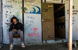 24.06.2016, Dschungelcamp, Calais, FRA, der Dschungel von Calais, im Bild ein junger Migrant vor einem Afghanischen Restaurant. Das Camp ist eine provisorische Zeltstadt nahe der französischen Stadt Calais. Mehrere tausend Menschen kampieren dort in Zeltunterkünften und warten auf eine Möglichkeit zur illegalen Weiterreise durch den Eurotunnel nach Großbritannien. a young migrant in front of a Afghan Restaurant. The Calais Jungle is the nickname given to a migrant encampment, where migrants live while they attempt illegally to enter the United Kingdom at the Jungle Camp of Calais, France on 2016, 06, 24. EXPA Pictures © 2016, PhotoCredit: EXPA, JFK