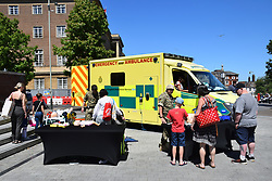 NHS 70th birthday event in central Norwich, June 2018 UK. Event co-incided with Armed Forces Day so soldiers were present to demonstrate the ambulance