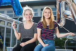 © Licensed to London News Pictures . 18/08/2016 . Wigan , UK . ELLIE LEYLAND and ALEXANDRA BATTERSBY who are going on to be apprentice construction trainees . Students at Winstanley College in Wigan collect their A-Level results . Photo credit: Joel Goodman/LNP