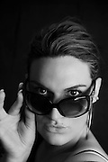 black and white portrait of female model wearing sunglasses