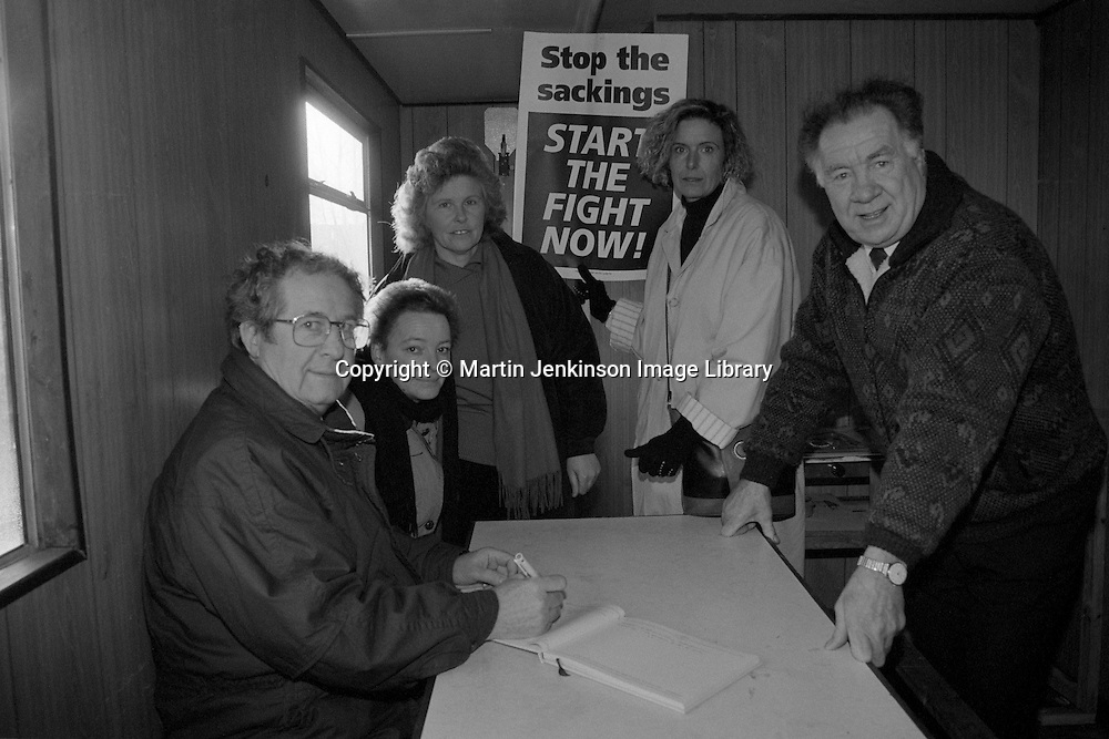 Doncaster Council Leader Gordon Gallimore (left) signs the visitors book at the Women Against Pit Closures 'pit camp' at the closure threatened Markham Main Colliery. Armthorpe. Looking on are Aggie. Anne Scargill. Brenda Nixon and Cllr JR Quinn. 11 January 1993