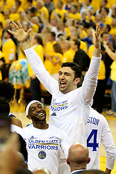 The Golden State Warriors' Zaza Pachulia and Ian Clark celebrate after defeating the Cleveland Cavaliers, 129-120, in Game 5 of the NBA Finals at Oracle Arena in Oakland, Calif., on Monday, June 12, 2017. (Photo by Ray Chavez/Bay Area News Group/TNS) *** Please Use Credit from Credit Field ***