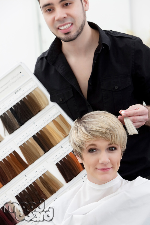 Hairdresser suggesting hair shades to customer