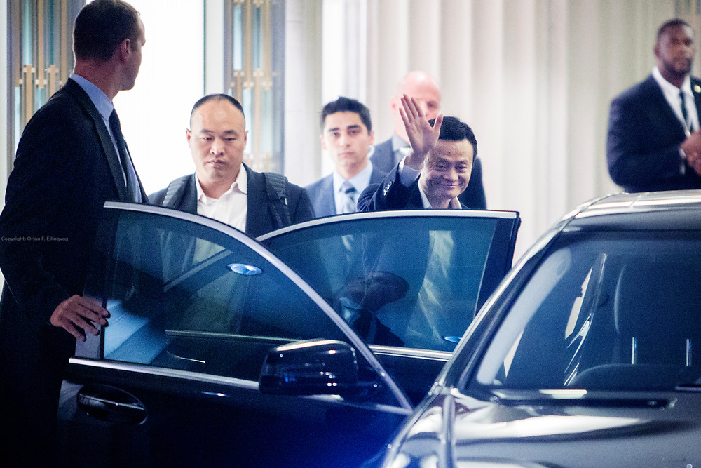 The CEO of Alibaba, Jack Ma, entering a limousine after his company held its initial public offering – IPO – at the Waldorf Astoria Hotel in New York.