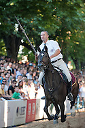 Bara, the first day of the Sinjska Alka (now in its 298th year), in Sinj, Croatia (2 August 2013). The Alka is a knightly tournament dating back to 1715, in which riders compete to spear a small metal ring from a galloping horse. The Alka is inscribed on the UNESCO list of Intangible Cultural Heritage. Pictured here, Alen Filipovic-Grcic, winner of the 298th Bara.