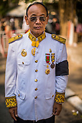 "04 FEBRUARY 2013 - PHNOM PENH, CAMBODIA: A Cambodian government official in his official mourning uniform makes his way to the cremation of King-Father Norodom Sihanouk in Phnom Penh. Norodom Sihanouk (31 October 1922 - 15 October 2012) was the King of Cambodia from 1941 to 1955 and again from 1993 to 2004. He was the effective ruler of Cambodia from 1953 to 1970. After his second abdication in 2004, he was given the honorific of ""The King-Father of Cambodia."" Sihanouk died in Beijing, China, where he was receiving medical care, on Oct. 15, 2012.    PHOTO BY JACK KURTZ"