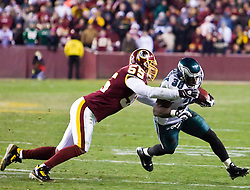 Philadelphia Eagles running back Brian Westbrook (36) rushes to avoid a tackel from Washington Redskins defensive end Jason Taylor (55).  The Washington Redskins defeated the Philadelphia Eagles 10-3 in an NFL football game held at Fedex Field in Landover, Maryland on Sunday, December 21, 2008.