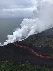 "Handout photo taken on May 21, 2018 of KÄ«lauea Volcano — Laze. Lava continues to enter the sea at two locations this morning. During this morning's overflight, the wind was blowing the ""laze"" plumes along the shoreline toward the southwest. Photo by usgs via ABACAPRESS.COM"