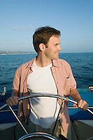 Man at Helm of Sailboat