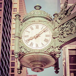 Chicago clock  retro picture. The famous Chicago clock is on the Macy's building and is one of the Marshall Fields Great Clocks. Photo has an old vintage retro tone. Image Copyright © Paul Velgos All Rights Reserved.