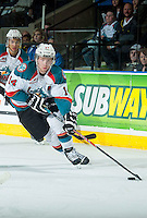 KELOWNA, CANADA - MARCH 27: Rourke Chartier #14 of Kelowna Rockets skates with the puck against the Tri-City Americans on March 27, 2015 at Prospera Place in Kelowna, British Columbia, Canada.  (Photo by Marissa Baecker/Shoot the Breeze)  *** Local Caption *** Rourke Chartier;