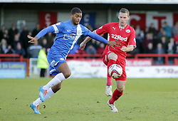 Peterborough United's Mark Little in action with Crawley Town's Andy Drury - Photo mandatory by-line: Joe Dent/JMP - Tel: Mobile: 07966 386802 01/03/2014 - SPORT - FOOTBALL - Crawley - Broadfield Stadium - Crawley Town v Peterborough United - Sky Bet League One