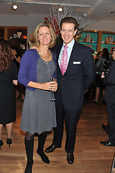 JAMES & JULIA OGILVY at the Linley Christmas party at Linley, 60 Pimlico Road, London on 20th November 2012.