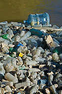 Pile of Plastic bottle pollution floating in the Alamo River, flowing into the Salton Sea, Imperial Valley, California