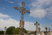 Rusting iron crosses on graves in a rural french hamlet in Indre-et-Loire.