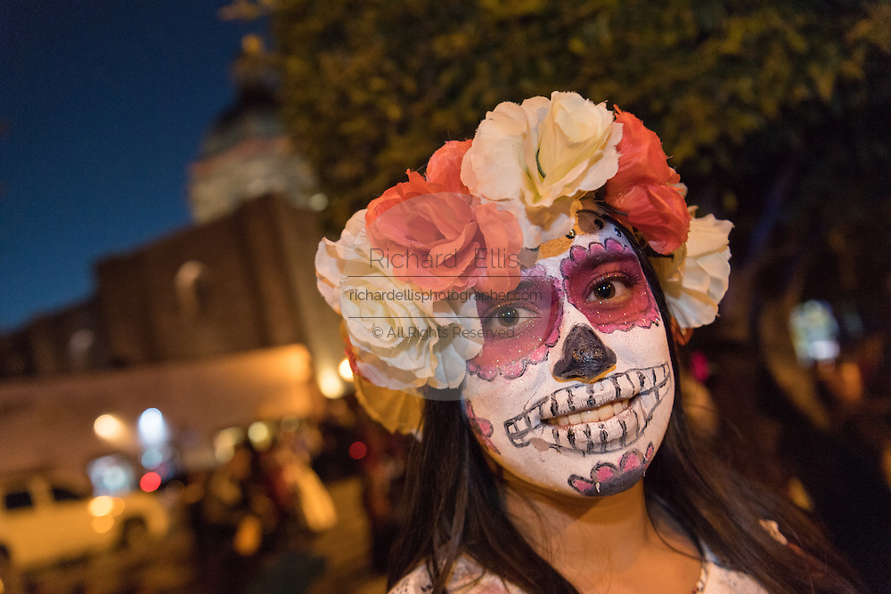A young woman dressed as La Calavera Catrina during the Day of the Dead festival in the Plaza Civica October 28, 2016 in San Miguel de Allende, Guanajuato, Mexico. The week-long celebration is a time when Mexicans welcome the dead back to earth for a visit and celebrate life.