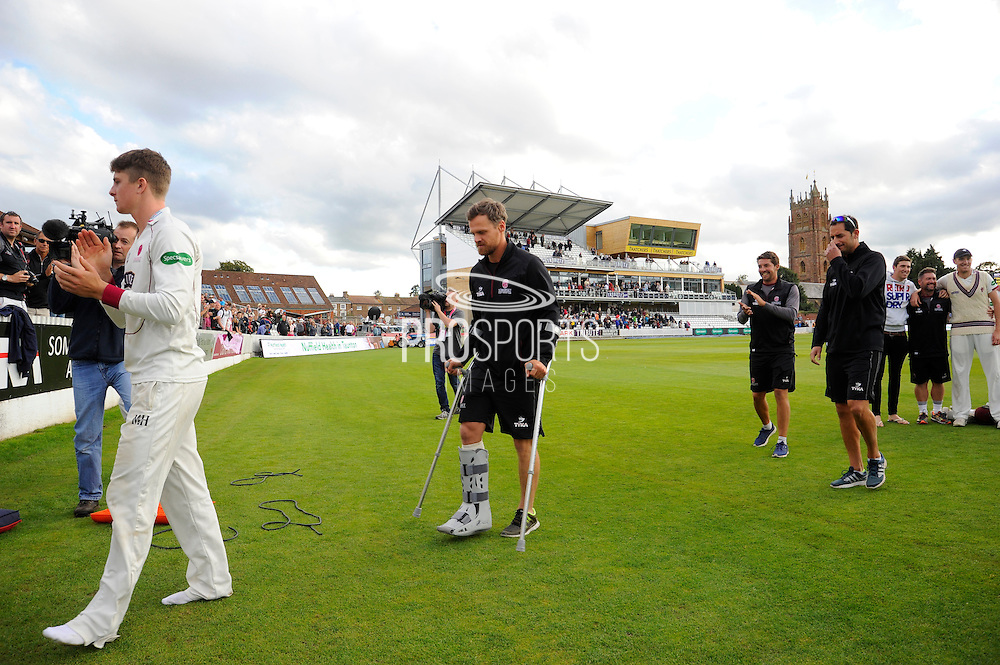 James Hildreth on the parade around the County Ground after Somerset beating Nottinghamshire, wearing his boot on the leg which was fractured during the Specsavers County Champ Div 1 match between Somerset County Cricket Club and Nottinghamshire County Cricket Club at the Cooper Associates County Ground, Taunton, United Kingdom on 22 September 2016. Photo by Graham Hunt.
