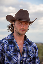 good looking cowboy with blue eyes and brown hair