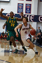 Jan 9, 2012; Moraga CA, USA;  St. Mary's Gaels guard Matthew Dellavedova (4) dribbles past San Francisco Dons forward Perris Blackwell (22) during the first half at McKeon Pavilion.  St. Mary's defeated San Francisco 87-72. Mandatory Credit: Jason O. Watson-US PRESSWIRE
