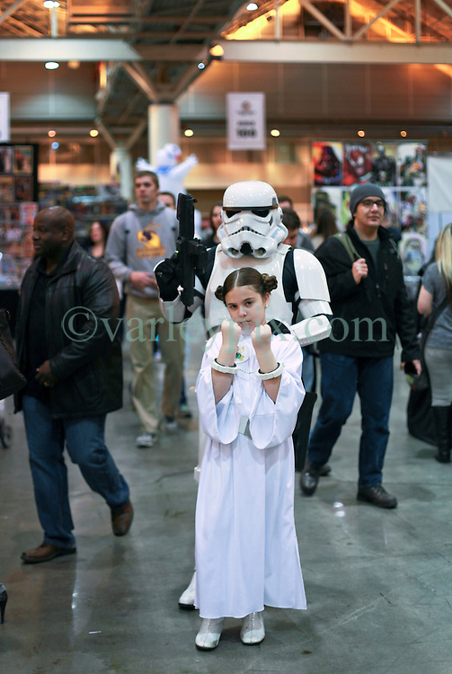 10 January 2015. New Orleans, Louisiana. <br /> Scenes from the Wizard World New Orleans Comic Con 2015 at the Morial Convention Center. A Stormtrooper arrests Princess Leia.<br /> Photo; Charlie Varley/varleypix.com