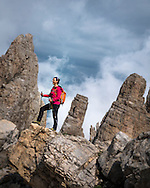"""Val di Fiemme, Trentino, Italy, August 2014. Rifugio Torre di Pisa. It is the only mountain refuge in the Latemar group and is perched on Cavignon peak at 2671 Meters. Why """"Torre di Pisa""""? Near the hut you can see a 20-meter-high leaning pinnacle which looks like the famous leaning tower of the cathedral of Pisa. It is just because of this likeness that the refuge is called """"Torre di Pisa"""". Trentino offers an extraordinary adventure through landscapes and different environments. A journey suspended between the Alps and the Mediterranean, from the crispy air of the Dolomites, to the mild climate of the lakes and of many other lakes suitable for swimming and water sports such as swimming, sailing and windsurfing. Trentino welcomes you with its typical Italian flair: Just relax, sip your aperitif in the sunset and enjoy the food and the atmosphere. If you're more active, you can experience the thrill of Alpine scenery, through a vast network of trails for hikers and mountain bikers. Or, simply, you can enjoy the green woods and meadows, the ideal surrounding to spend a relaxing holiday with your family. Photo by Frits Meyst / Meystphoto.com"""
