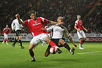 Photo: Lee Earle.<br /> Charlton Athletic v Manchester United. The Barclays Premiership. 23/08/2006. Charlton's Hermann Hreidarsson (L) battles with Mikael Silvestre.