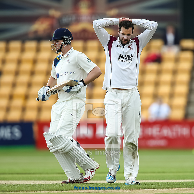 Alex Lees of Yorkshire County Cricket Club (left) with a disconsolate Matthew Spriegel of Northamptonshire County Cricket Club (right) during the LV County Championship Div One match at the County Ground, Northampton, Northampton<br /> Picture by Andy Kearns/Focus Images Ltd 0781 864 4264<br /> 01/06/2014