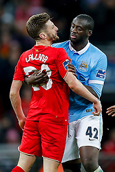 Adam Lallana of Liverpool and Yaya Toure of Manchester City come together - Mandatory byline: Rogan Thomson/JMP - 28/02/2016 - FOOTBALL - Wembley Stadium - London, England - Liverpool v Manchester City - Capital One Cup Final.