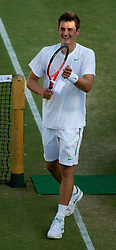 25.06.2011, Wimbledon, London, GBR, Wimbledon Tennis Championships, im Bild Bernard Tomic (AUS) celebrates after winning the Gentlemen's Singles 3rd Round match on day six of the Wimbledon Lawn Tennis Championships at the All England Lawn Tennis and Croquet Club, EXPA Pictures © 2011, PhotoCredit: EXPA/ Propaganda/ *** ATTENTION *** UK OUT!