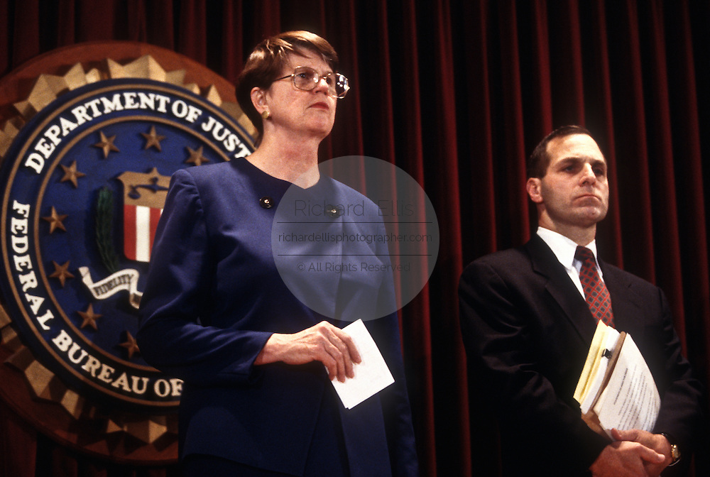 Attorney General Janet Reno, accompanied by FBI Director Louis Freeh, at FBI headquarters December 18, 1996  in Washington, DC.  Reno announced the arrest of FBI agent Earl Edwin Pitts on charges of selling secrets to Russia.