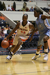 Tiffany Sardin (33) dribbles towards the baseline against UNC.  Sardin's 19 points and 10 rebounds were not enough for the Hoos, who lost 72-60.