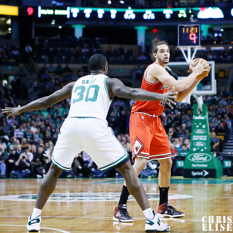 13 February 2013: Chicago Bulls center Joakim Noah (13) looks to pass the ball over Boston Celtics power forward Brandon Bass (30) during the Boston Celtics 71-69 victory over the Chicago Bulls at the TD Garden, Boston, Massachusetts, USA.
