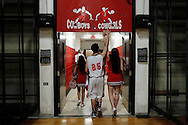 "Premont Senior Luis ""Yayo"" Torres and his girlfriend, junior cheerleader Mariela Navarro, touch the basketball sign as they walk out of the gym hand in hand Tuesday, Feb. 14, 2012 following Premont's final basketball game of the year."