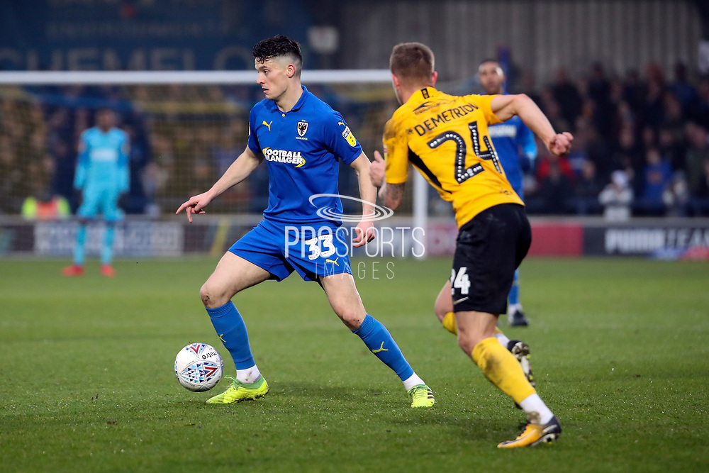 AFC Wimbledon midfielder Callum Reilly (33) taking on Southend United defender Jason Demetriou (24) during the EFL Sky Bet League 1 match between AFC Wimbledon and Southend United at the Cherry Red Records Stadium, Kingston, England on 1 January 2020.