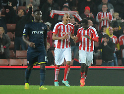 Stoke's Mame Biram Diouf celebrates his goal with Stoke's Steven N'Zonzi - Photo mandatory by-line: Dougie Allward/JMP - Mobile: 07966 386802 - 29/10/2014 - SPORT - Football - Stoke - Britannia Stadium - Stoke City v Southampton - Capital One Cup - Fourth Round