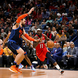 Feb 14, 2019; New Orleans, LA, USA; New Orleans Pelicans guard Jrue Holiday (11) drives past Oklahoma City Thunder center Steven Adams (12) during the second half at the Smoothie King Center. Mandatory Credit: Derick E. Hingle-USA TODAY Sports