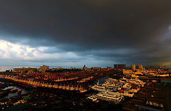 Aug. 28, 2017 - Beihai, China - Aerial view over the Dianjian fishing harbor in Beihai City, south China's Guangxi Zhuang Autonomous Region. Because of Typhoon Pakhar, which landed early Sunday in neighboring Guangdong Province, Beihai City witnessed rapid changes of weather conditions in the forms of gales, thunderstorm, clouds and morning glow early Monday.  (Credit Image: © Huang Xiaobang/Xinhua via ZUMA Wire)