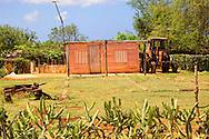 Farm house and tractor near  Velasco, Holguin, Cuba.