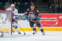 KELOWNA, CANADA - OCTOBER 26: Mitchell Prowse #5 of the Victoria Royals checks Calvin Thurkauf #27 of the Kelowna Rockets behind the net on October 26, 2016 at Prospera Place in Kelowna, British Columbia, Canada.  (Photo by Marissa Baecker/Shoot the Breeze)  *** Local Caption ***