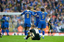 LONDON, ENGLAND - Saturday, May 17, 2008: Cardiff City's Stephen McPhail lies dejected as Portsmouth's Milan Baros, Papa Bouba Diop and Hermann Hreidarsson celebrate during the FA Cup Final at Wembley Stadium. (Photo by David Rawcliffe/Propaganda)